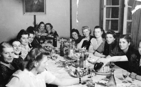 Female guards of the Majdanek concentration camp gather around the table to celebrate a birthday, March 1944. Average faces, bestial minds.
