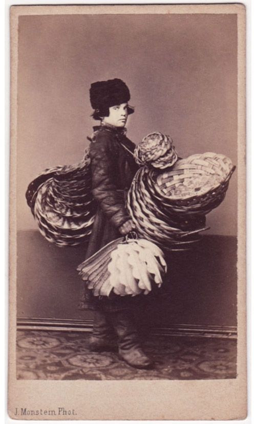 Fancy basket seller Check out the collection of photographs of the common Russian people created by several photographers in the 19th century. These photos will help you catch the essence of the common man, a seller, a craftsman or a peasant, living in the country at that time.
