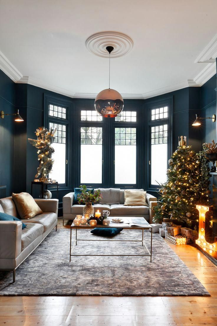 Dark Walls In The Living Room With A Large Bay Window Lettin