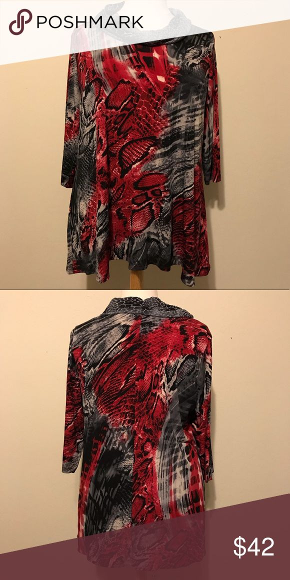 """EUC Susan Graver red, black & gray tunic top 1X This top is in excellent condition. The body of the shirt is made of 95% polyester and 5% spandex while the combo portion is made of 100% polyester. It is machine washable. The bottom hem has a slight high-lo look to it which adds to the beautiful flow of the top. Approximate measurements are bust 50"""", waist 50"""", bottom hem 48"""", sleeve 17"""", bicep 10"""" and total length (front) 30"""". Reasonable offers welcome. Susan Graver Tops Tunics"""