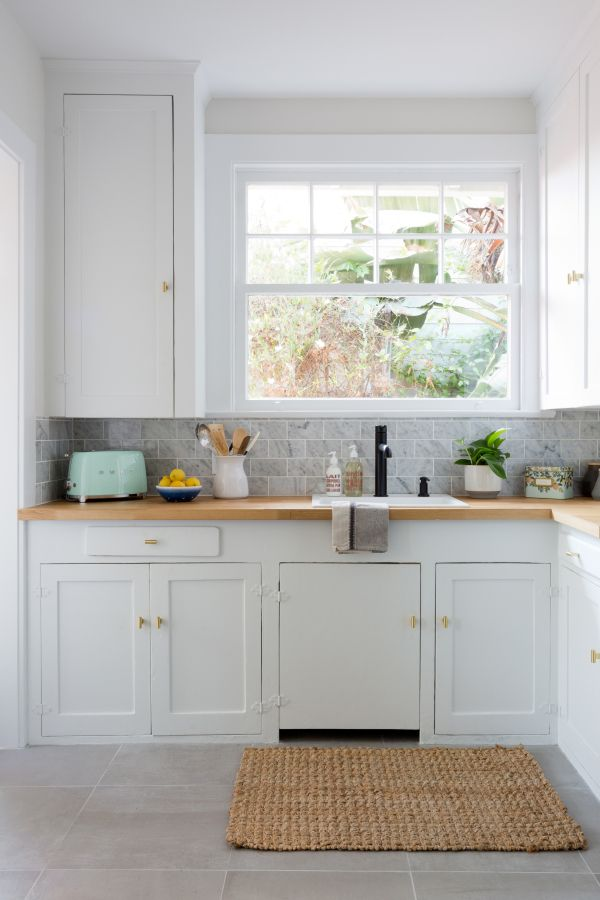 New white cabinets and brass nobs: http://www.stylemepretty.com/living/2016/09/21/crafting-a-dream-bungalow-in-venice-beach/ Photography: Amy Bartlam - http://www.amybartlam.com/