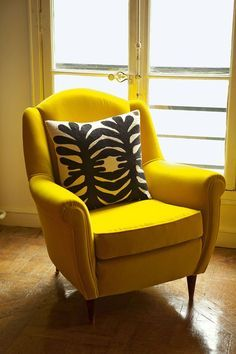 Vintage yellow armchair and printed cushion by India Mahdavi for Petits Objets (Photo: Derek Hudson)