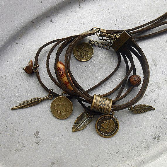 Free Spirit - Bracelet Windswept - dark brown leather strands with various charms feathers and coins real tiger's eye & a dried Amazone nut