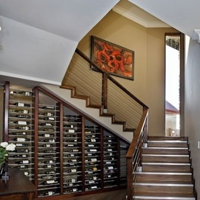 Want this!  Why use up kitchen counter space with a wine rack when you could have the whole unused wall?!