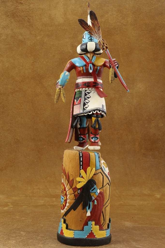 This Hopi Kachina Doll was created by Leonard Taho, master Native American wood carver sometime in the 1990's. Originally, the kachina doll was devised as a teaching tool given to children as part of their cultural and religious training. Leonard has brought the Rattle Kachina to life in this detailed carving with a multi-colored base that is a work of art in itself. The base includes a colorful stepped mesa & a traditional Hopi Sunface! $880.00 #Alltribes