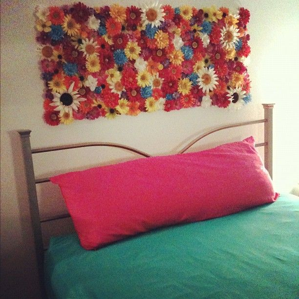 My Flower Headboard Above My Bed!    This project can be used for many other things as well besides just headboards!    Things You'll Need:  *Tri Fold Cardboard Poster Board   (Cut to the size you want)  *Fake Flowers Removed From Stems   (Trim backs of flowers if necessary)  *Hot Glue Gun -All you do is hot glue the back of the flowers to the cardboard and once project is complete secure it to your wall! Easy!