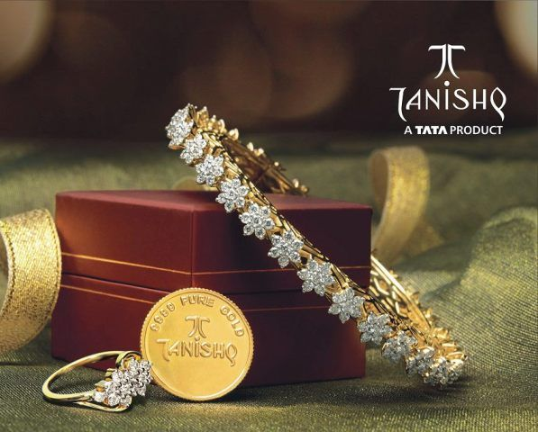 Gold and Diamond jewellery designs: tanishq diamond bangle and diamond ring