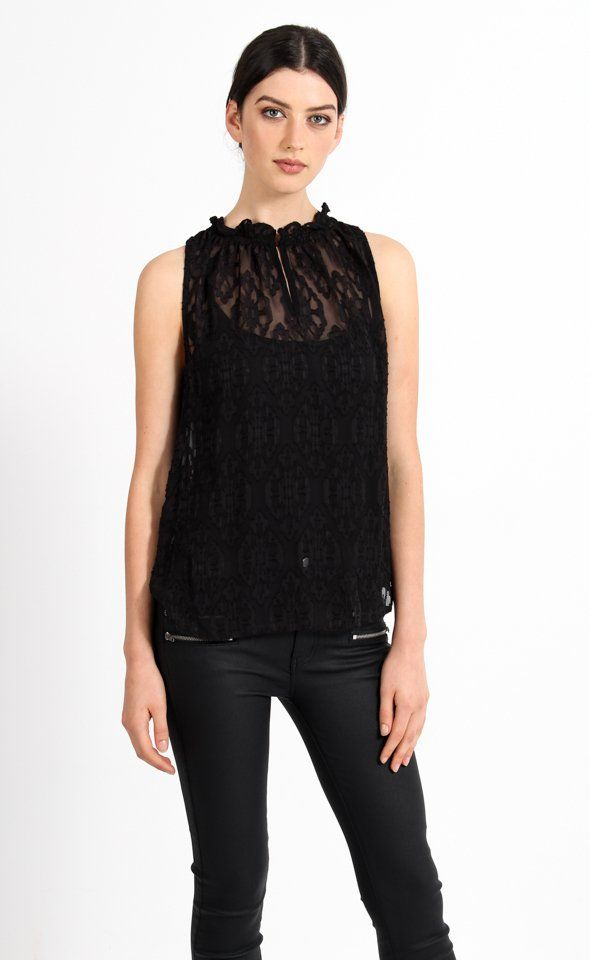 Elegantly designed with the burnout detailing, you'll love this subtle pattern. The frill neck makes this on trend top a fashion statement.