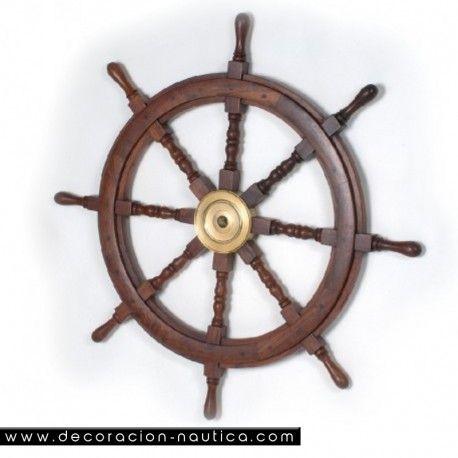 RUEDA DE TIMÓN Reproducción artesana de una rueda de timón utilizada en los grandes veleros del S. XIX. Rueda de timón decorativa con ocho brazos realizada en madera de palisandro con el buje central en latón.   Medidas: Alto:93.00 x Largo:93.00 x Ancho:5.00 cm