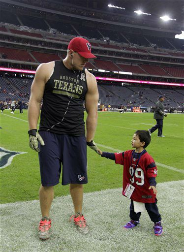 Houston Texans defensive end J.J. Watt, left,  slaps hands with Manny Butler, 3, before an NFL football game  <span class=meta>(AP Photo/ Patric Schneider)</span>