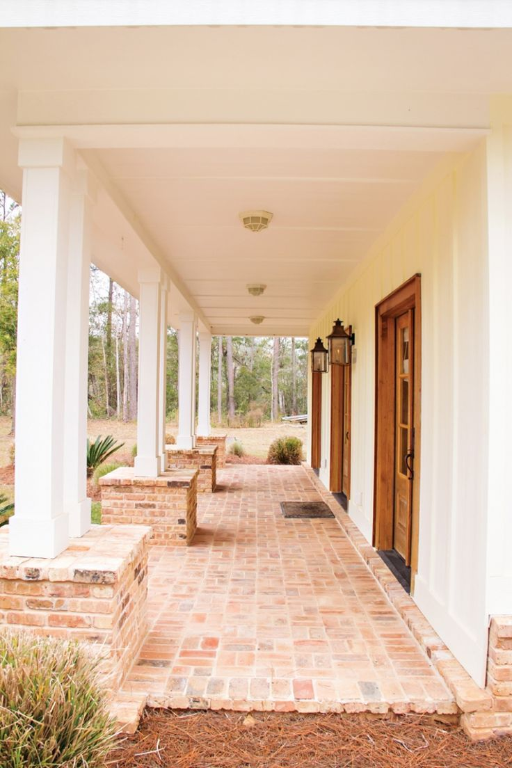 Love this front porch. The brick, the white, the stained door and window frames.