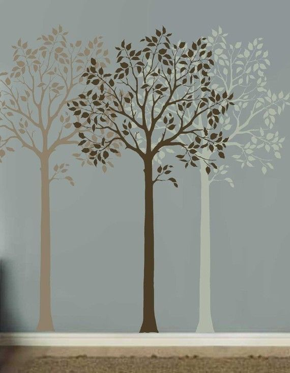 a simple tree stencil in different shades adds depth and color to this otherwise boring wall