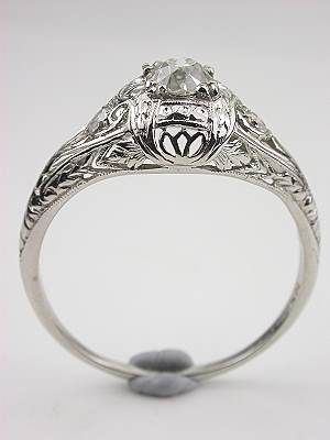 Edwardian antique filigree ring. Beautiful design, not overly large stones. The uniformity in color is a bit boring, though.