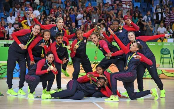 Team USA celebrates winning the gold medal in the women's basketball gold medal…