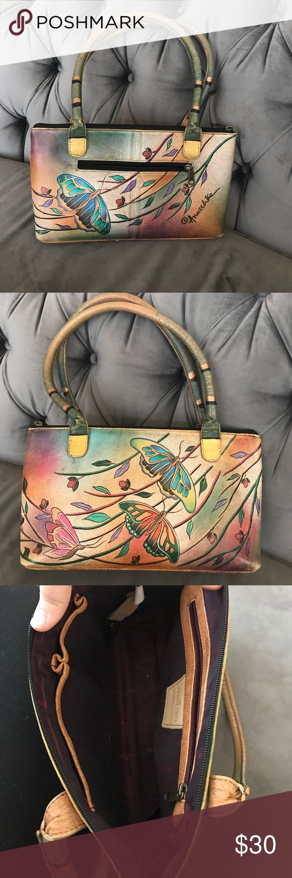 Hand painted Purse Used.  Some marks on the inside.  Butterfly pattern. Neutral colors. Hand or shoulder bag.  Outside looks like new Anuschka Bags Shoulder Bags