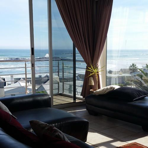 Enjoy stunning panoramic views of the Superior Penthouse Unit,                   The master bedroom is a sea-facing room and                                   has a private balcony. The second room has a partial view of the sea and Table Mountain