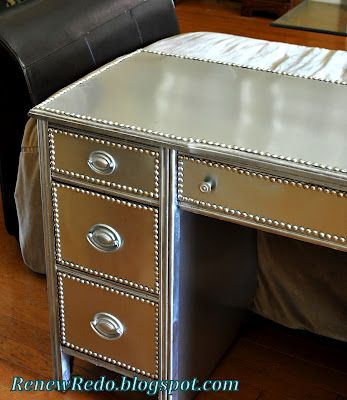 Tutorial on how to make stainless steel looking furniture using paint, flashing and nail-head trim