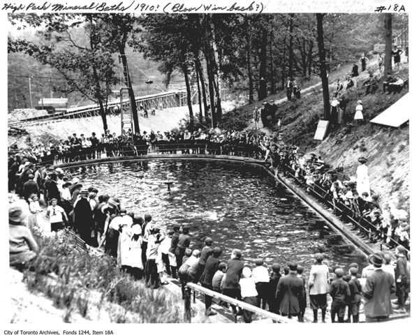 """toronto high park - The High Park Mineral Baths, nicknamed """"The Minnies,"""" were located north of Bloor in a natural swimming hole. In the background a deep ravine is being filled in for an extension of Boor St."""