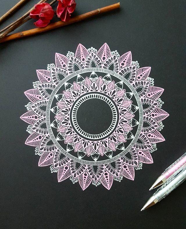 Mandala, pink and white gel ink on black paper