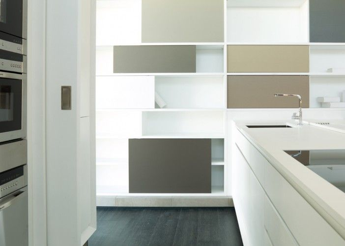 As with the G690, this kitchen features the chamfered edge detail although this time shown in the matt lacquered finish. Note also the unique shelving system incorporating coloured, sliding doors to create a unique design feature.