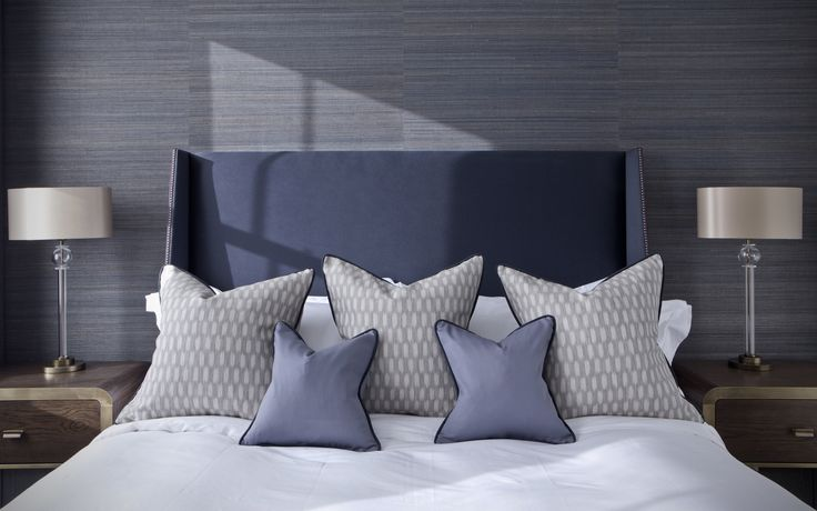 Our winged Beaufort headboard was specified by RFR Property's Interior Design Team for this elegant loft-style London apartment. The custom-made Beaufort with its classic studded detailing was upholstered in Kirkby Designs' Oxford in 'Midnight', creating a cool, sophisticated, yet welcoming look. #bespoke #luxuryheadboard simonhorn.com
