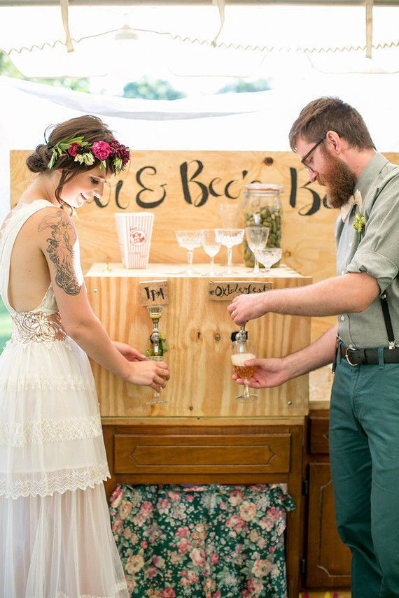 Guests will enjoy this beautifully constructed DIY rustic wedding drink station complete with dual spouts and custom beverages.  See more creative wedding ideas here: http://www.mywedding.com/wedding-ideas/do-it-yourself/gorgeous-wedding-details-you-can-definitely-diy/