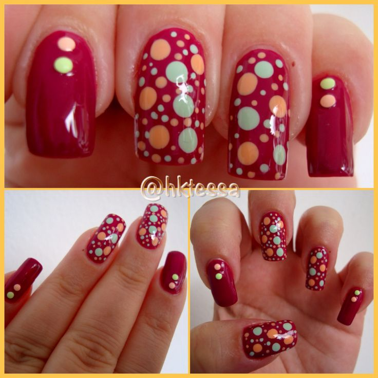 mooie rode nagellak met nailart in de vorm van stippen