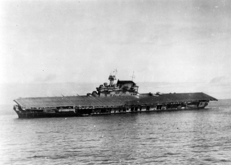 """""""Battle of Midway, June 1942. USS Yorktown (CV-5) lists heavily after she was abandoned during the afternoon of 4 June 1942. Note that two F4F-4 Wildcat fighters are still parked on her flight deck, aft of the island."""""""
