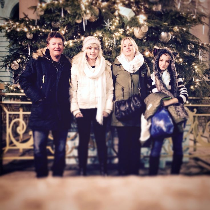 Family photo by the Christmas Tree outside the Bank of England Museum in London.