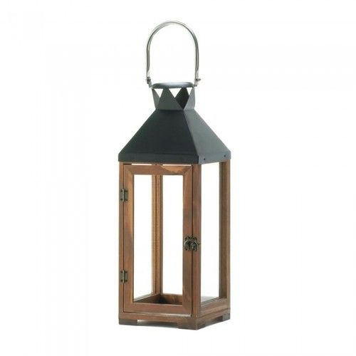 """The harmony of elegant wood and sleek black metal makes this tall candle lantern a designers dream come true. The clear glass panels let candlelight shine brightly and the oversized stainless steel hanging loop is the perfect finishing touch. Candle not included.   23 1/4"""" high with handle."""