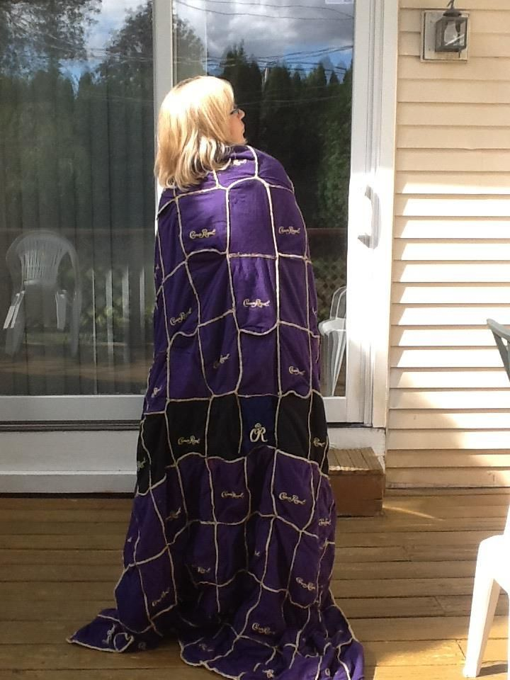 A blanket made from Crown Royal bags! I need to make James one of these. He has about 200 bags!