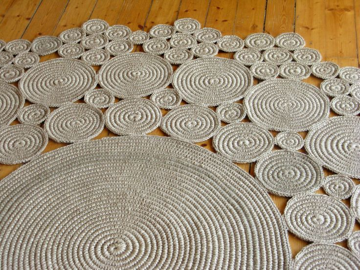 This crochet rug is made of 100% natural jute rope. I crochet jute string around jute rope to make spirals. It look`s cosy. I love the jute string, because it is sturdy and stretchy in the same time, so will have a long life. It is heavy rug and it will stable sit on its place.  Measurements: 72 in diameter / 184cm 0.4 thick / 1 cm 6 kg weight  Materials Used: Eco-friendly Jute is a plant fiber that is biodegradable, sustainable and durable.  If you need another size, please co...