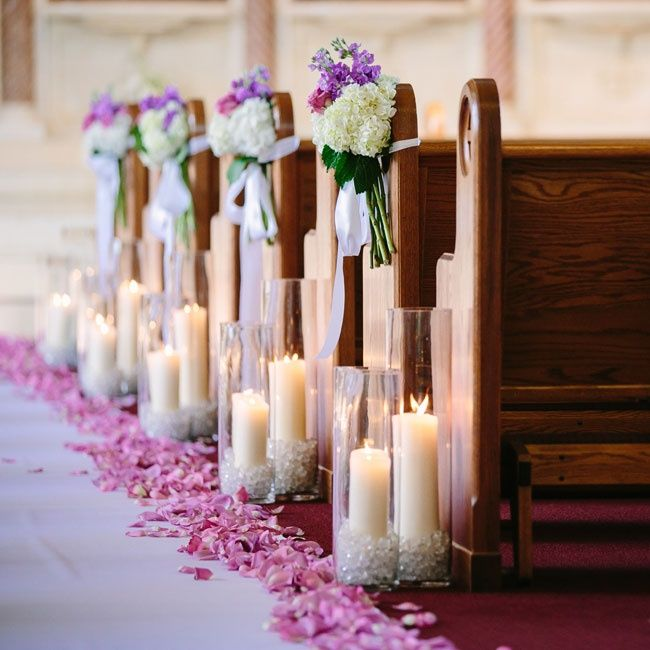 Enchanted Garden Wedding Theme | Purple and white blooms hung from the ends of the pews at the church ...