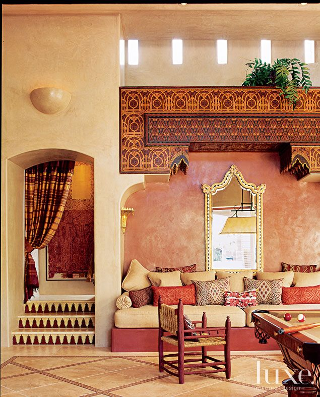 Many of the design elements in this game room including the intricately carved lintel were handmade by Moroccan artisans.