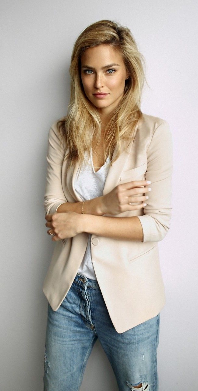 Shop this look on Lookastic:  http://lookastic.com/women/looks/blue-ripped-skinny-jeans-beige-blazer-white-v-neck-t-shirt/6451  — Blue Ripped Skinny Jeans  — Beige Blazer  — White V-neck T-shirt