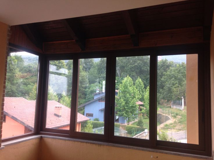 Veranda scorrevole tinta legno noce in alluminio Taglio Termico