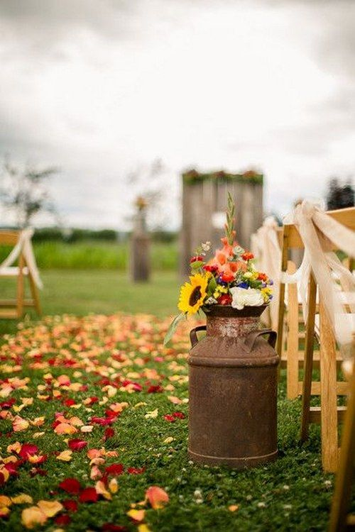 Wildflowers in vintage milk cans as rustic wedding ceremony decor / http://www.himisspuff.com/fall-wedding-ideas-themes/4/