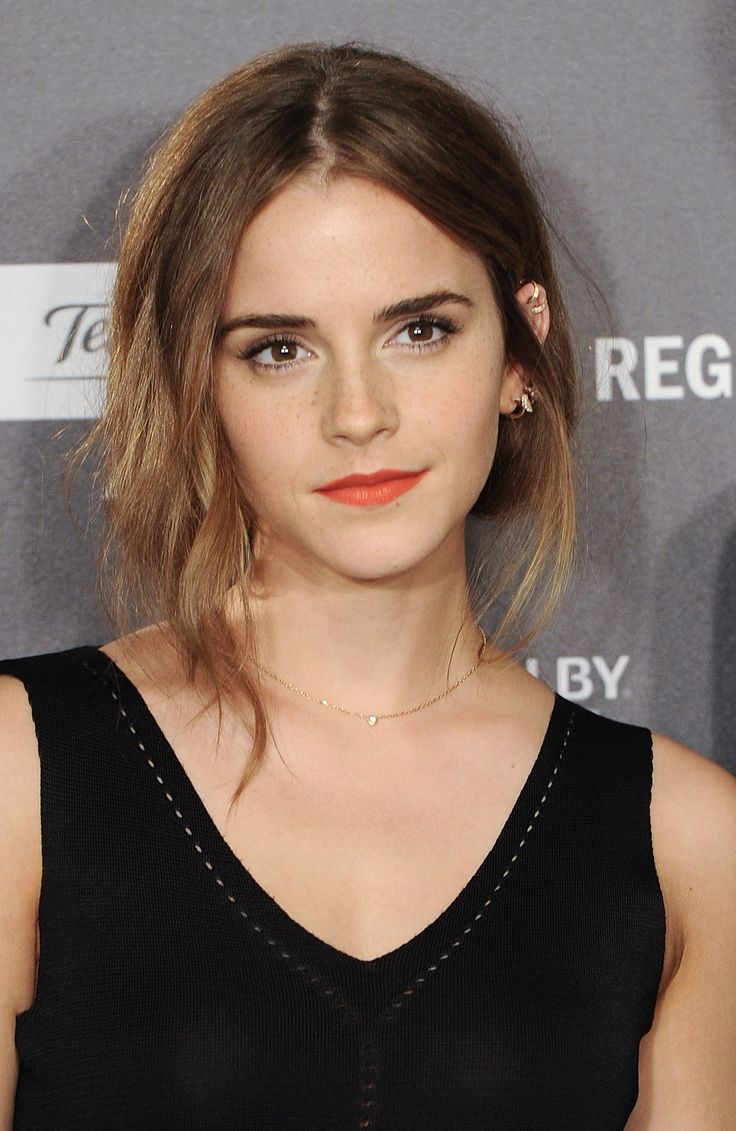 This hair style is EVERYTHING. Gather hair at the nape of your neck and tie together tightly, then pull out a few strands from both sides. For a look just like Emma's, curl the frontmost strand with a big-barrel curler.    - MarieClaire.com