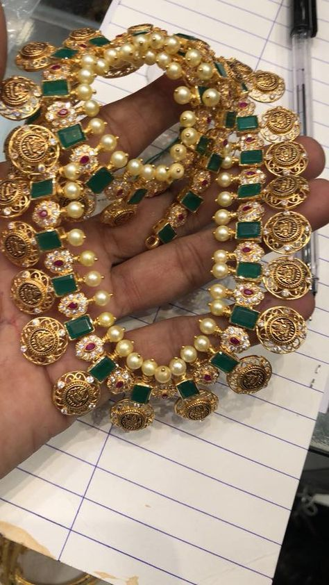 Stunning long haaram with lakshmi devi kasu hangings. Long haaram studded with white pink and green color emeralds and precious stones. Lognhaaram with flower design. 25 February 2018