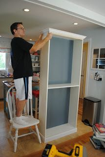 How to Add Molding to Billy Bookcases Follow link for painting & waxing tips-excellent way to make inexpensive book shelves an upper class look :)