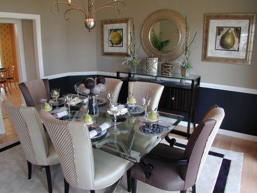 Navy is a solid, grounding color, and it works well below the chair rail, lending depth and elegance to this traditional dining room.