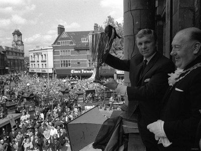 West Ham captain Bobby Moore shows the European Cup-winners Cup to the fans.