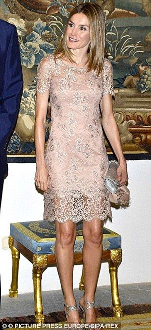 Princess Letizia is much more experimental in the fashion stakes than British royals. Here, she is pictured looking chic in a nude lace dress at the Almudaina Palace in Palma