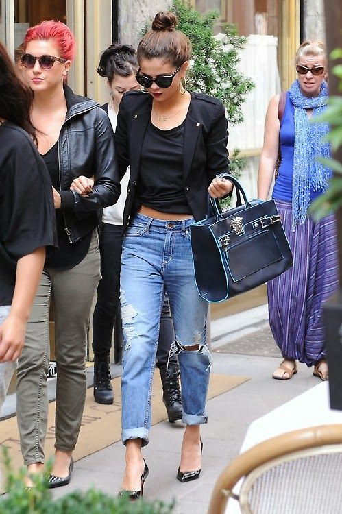 Topknot; Raybans; Cool earrings; Tied Black tee to show midriff; Black blazer; Distressed bf jeans; Black heels and bag
