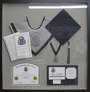 Paulding County Georgia High School Graduation Shadow box with hat, tassel, high school diploma and graduation announcement.  The Gallery at Brookwood www.thegallery.us 770-941-3394 Your Custom Framing Expert