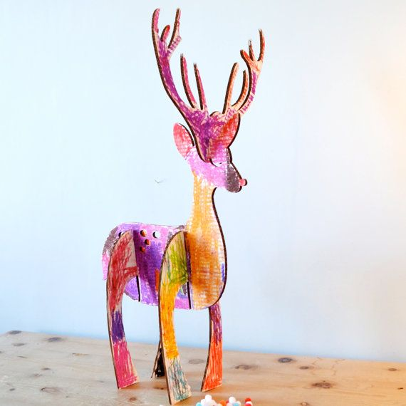 Make Your Own Festive Reindeer, lasercut corugated cardboard. Young children decorated this with oil pastels