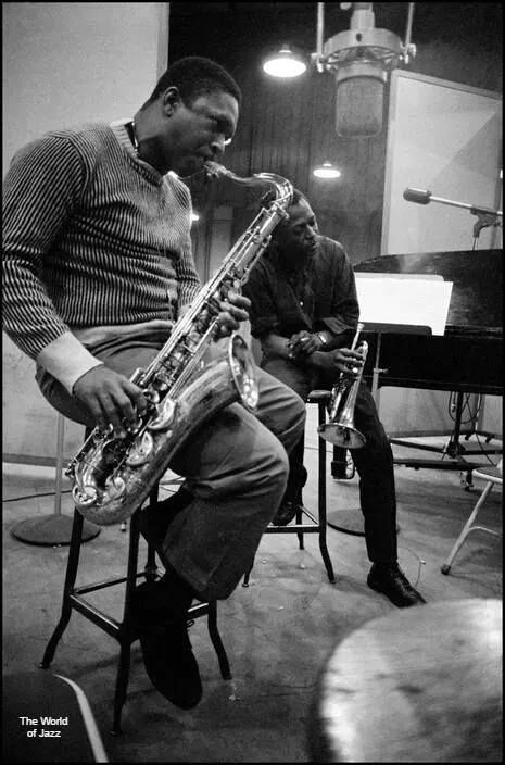John Coltrane & Miles Davis during a recording session at Columbia Records, 1958