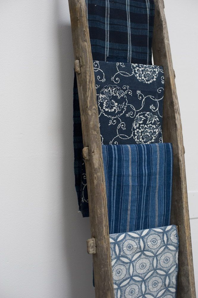 Ladder for displaying textiles and blanket. ladder textile display. Great idea. @Jess Pearl Liu Dassing thought of you!