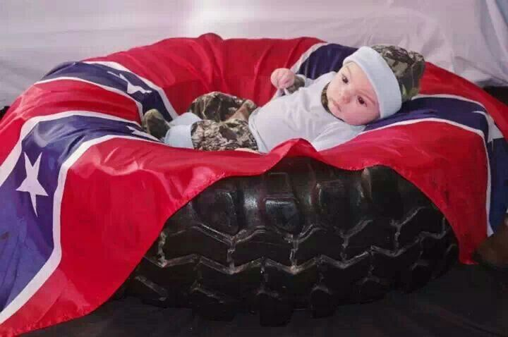 Redneck baby picture..... Grab a agressive mud tire a reble flag and a camo outfit..... Adorible