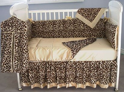 The bumper and crib skirt are in cheetah velvet with  butter satin piping and a band crib quilt. Oh I wish I had 600 extra dollars.